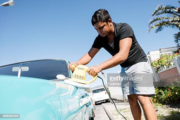 Man Polishing His Vintage Car With A Polishing Machine