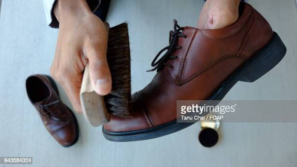 Man Polishing shoes