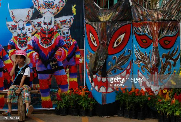 A man posed with the puppet are wear masks representing the spirits of the dead springing back to life during the annual Phi Ta Khon or Ghost...