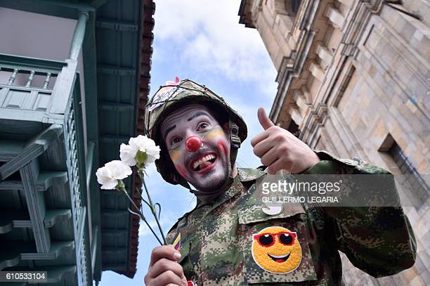 TOPSHOT A man poses as he gathers with others at Bogota's Bolivar main square on September 26 to celebrate the historic peace agreement between the...