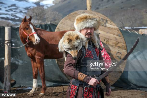 A man poses for a photo with a sword near a pavilion put up by Kyrgyz brothers Kenan and Ahmet Aytac emigrated from Afghanistan's Pamir plateau 36...