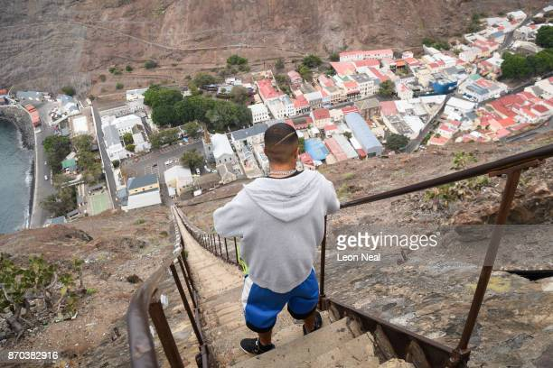 A man poses for a photograph at the top of the 699step Jacobs Ladder on October 22 2017 in Jamestown Saint Helena Following the introduction of...