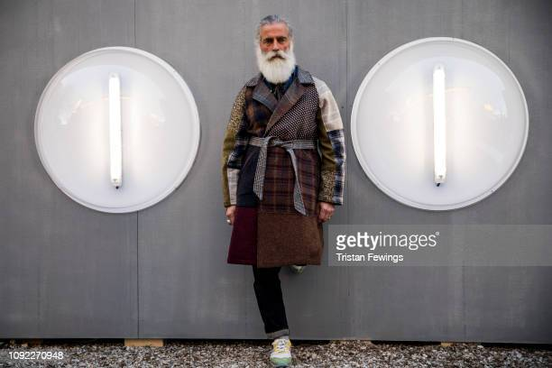A man poses for a photograph during the 95th Pitti Uomo at Fortezza Da Basso on January 10 2019 in Florence Italy