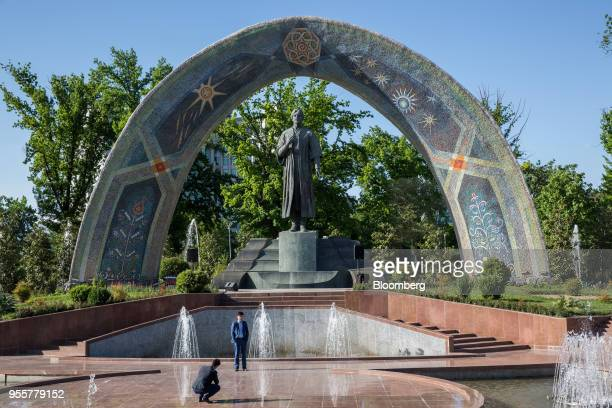 A man poses for a photograph in front of Rudaki Statue in Dushanbe Tajikistan on Saturday April 21 2018 Flung into independence after the Soviet...
