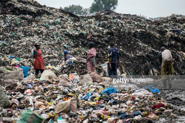 A man poses for a picture at the Dandora rubbish dump on March 14 2018 in Nairobi Kenya The Dandora landfield is located 8 Kilometer east of the city...