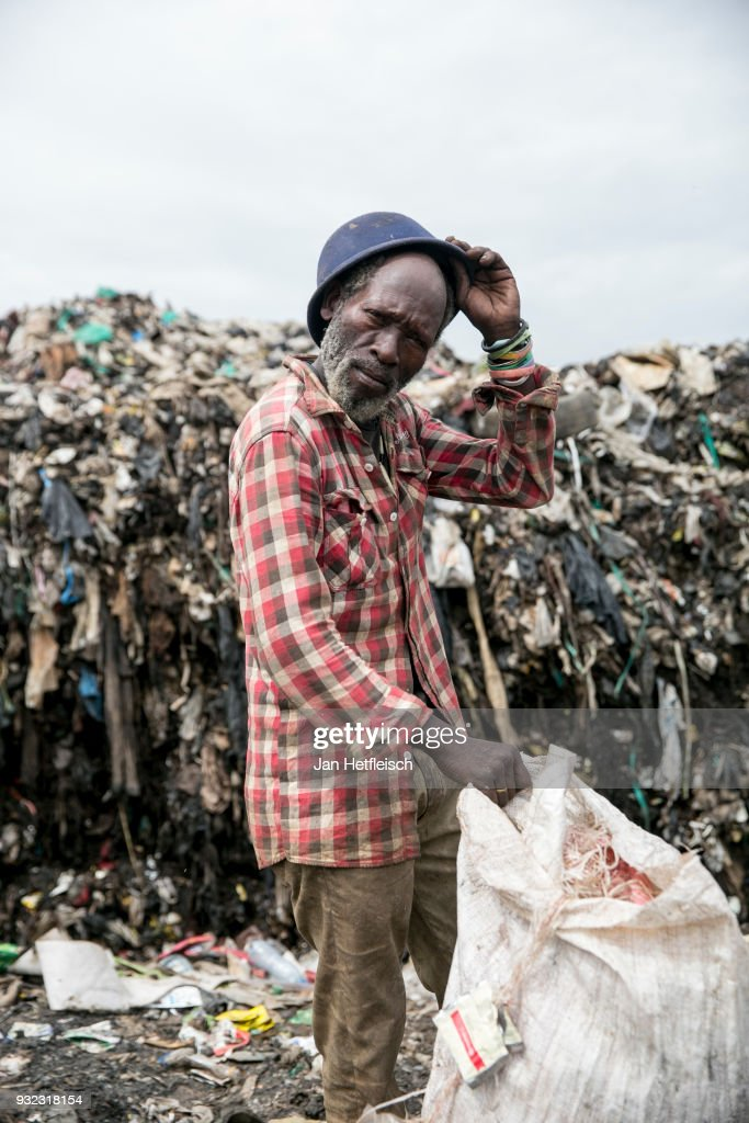 A man poses for a picture at the Dandora rubbish dump on March 14, 2018 in Nairobi, Kenya. The Dandora landfield is located 8 Kilometer east of the city center of Nairobi, the capital of Kenya. Every day, more than 2.000 metric tonnes of waste are dumped on this site. More than 3000 pickers work day by day at the sprawling 30-acre rubbish dump.