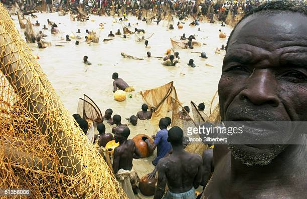 A man poses for a portrait while competing in the Argungu Fishing Festival on March 20 at the in Argungu Nigeria The Argungu Fishing Festival was...