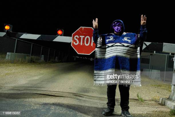 A man poses for photos as attendees gather to storm Area 51 at an entrance to the military facility near Rachel Nevada on September 20 2019