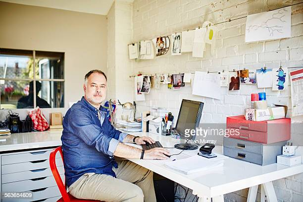 Man poses for portrait whilst working from home