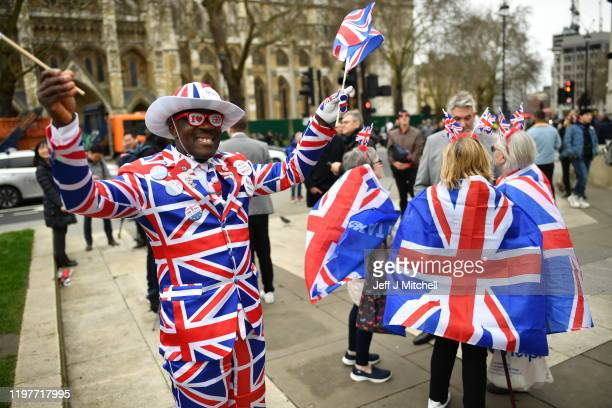 Man poses in a Union Jack suit at Parliament Square as people prepare for Brexit on January 31, 2020 in London, United Kingdom. At 11.00pm on Friday...