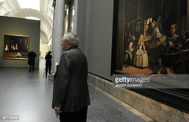 A man poses in front of the painting Las Meninas by Spaniard Diego Velazquez during the presentation of the painting The Daughters of Edward Darley...