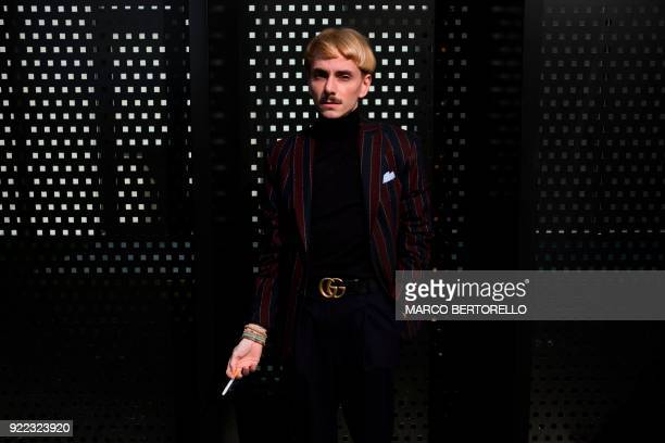 TOPSHOT A man poses prior to the women's Fall/Winter 2018/2019 collection fashion show by Gucci in Milan on February 21 2018 / AFP PHOTO / Marco...