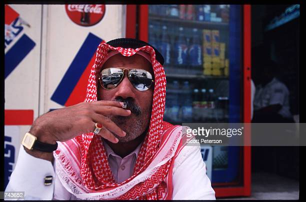 A man poses smoking a cigarette July 15 1996 in Jeddah Saudi Arabia Possessing twentyfive percent of the world's oil reserves and the Islamic shrines...