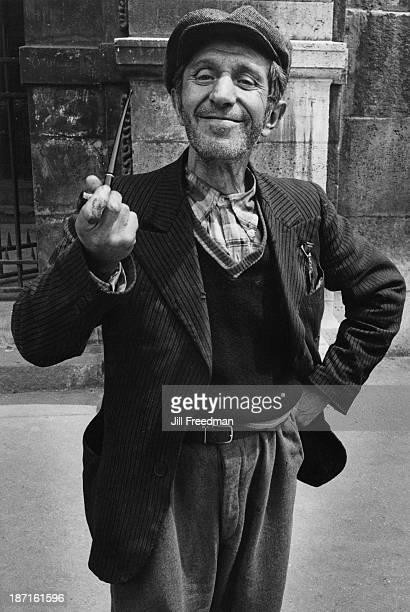 A man poses with his pipe in Paris France 1969