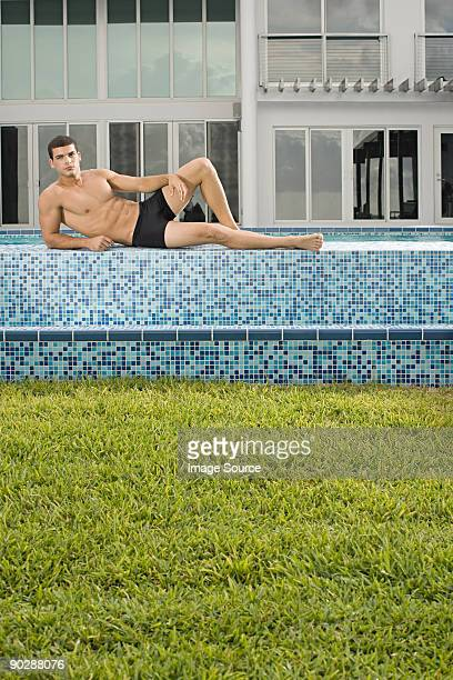 Man posing by pool