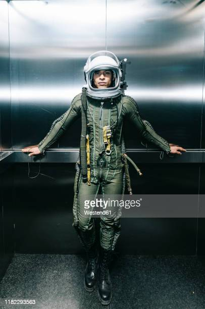 man posing dressed as an astronaut in an elevator - space suit stock pictures, royalty-free photos & images