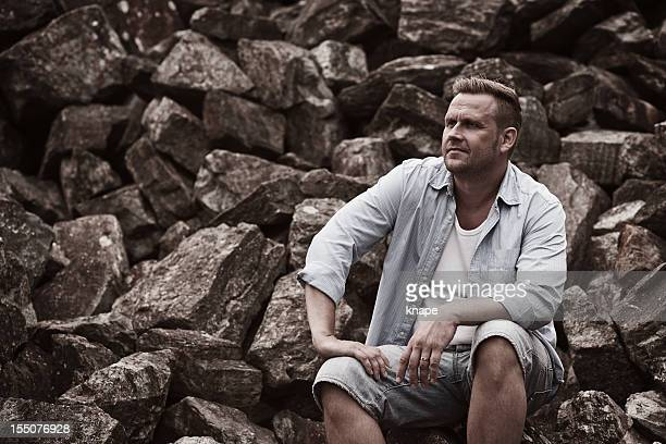 Man posing in a marble quarry