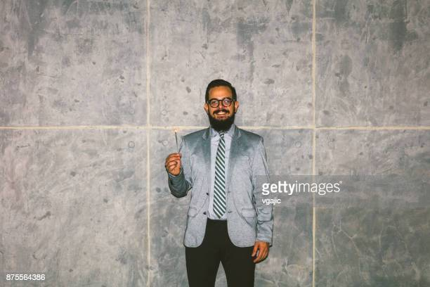 Man Posing in front of concrete wall