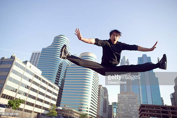 man posing midair - doing the splits stock pictures, royalty-free photos & images