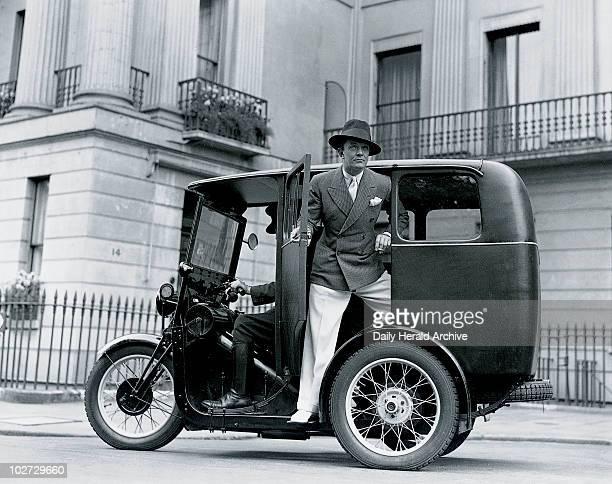 Man posing on a threewheeler taxi 27 June 1932