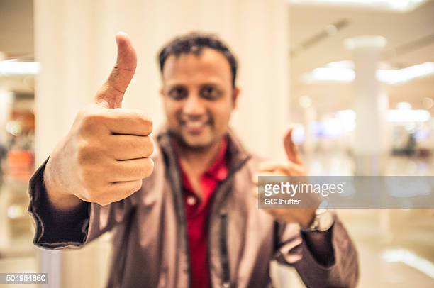 Man Posing - Thumbs Up in an indoor setting