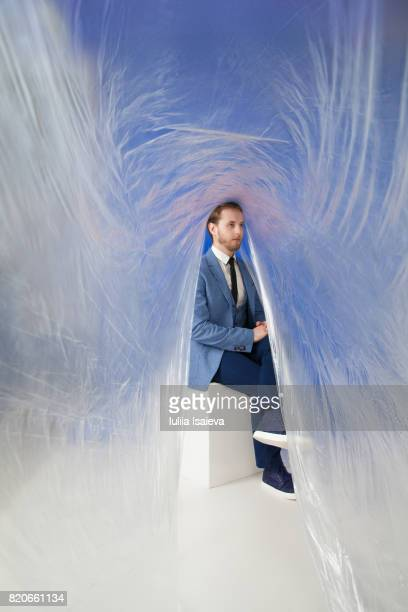 man posing under polyethylene foil - man wrapped in plastic stock pictures, royalty-free photos & images