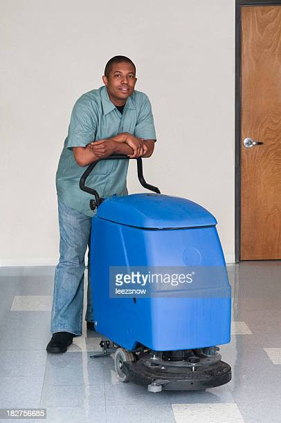 man posing while cleaning an office - janitorial services series - commercial cleaning stock photos and pictures