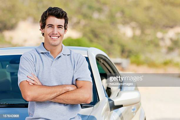 Man Posing With His Car