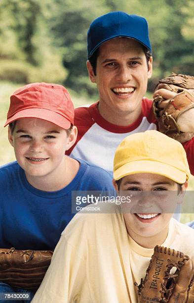 Man posing with sons