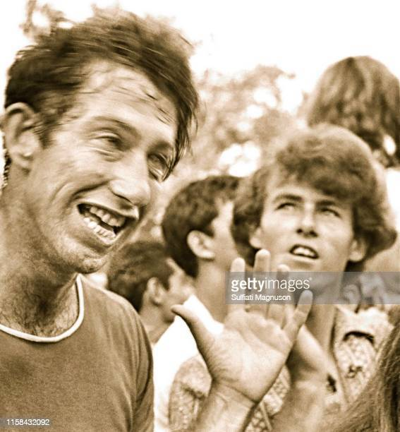 Man possibly on drugs and a young man with curly hair at the 1st Elysian Park Love-In on March 26, 1967 in Los Angeles, California.