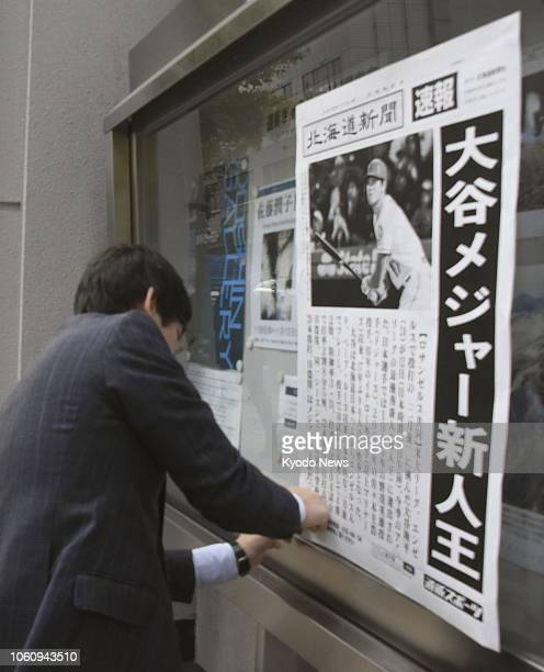 A man posts a copy of an extra edition of The Hokkaido Shimbun in Sapporo northern Japan on Nov 13 reporting that Shohei Ohtani of the Los Angeles...