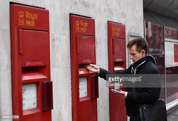 A man posts a letter in a mailbox of a Post Office on December 19 2016 in London England A strike at Crown post offices has closed around 50 of the...
