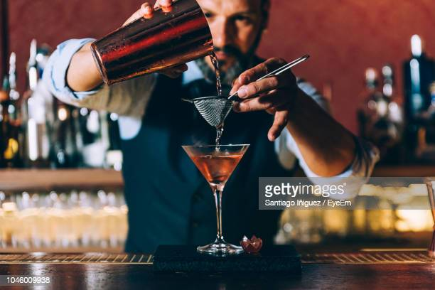 man pouring beer in glass - mixing stock pictures, royalty-free photos & images