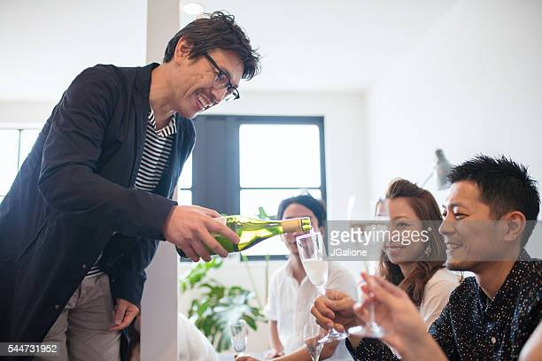 Man pouring Champagne