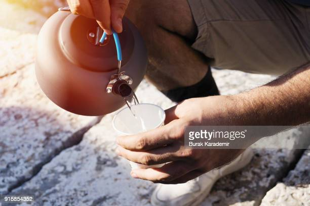 Man Pouring Hot Water In Cup