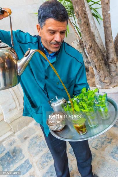 Man pouring mint tea at medina. Tunis city. Tunisia, Africa..