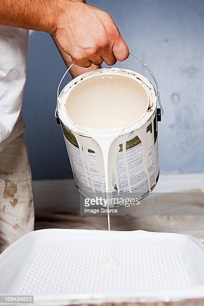 Man pouring paint