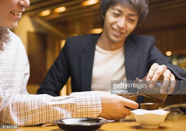 Man Pouring Sake