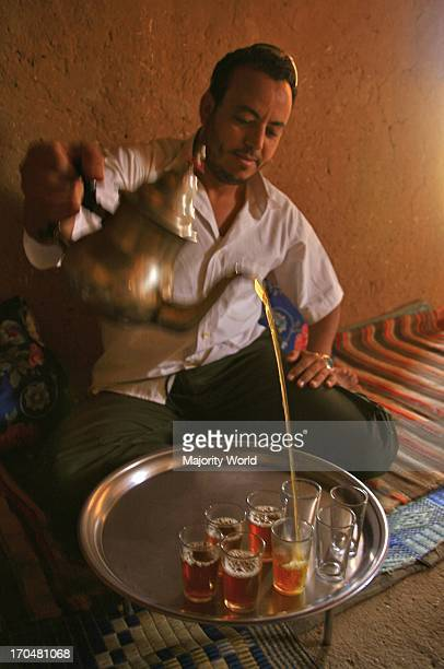 A man pouring tea in Moroccan style Morocco October 6 2006