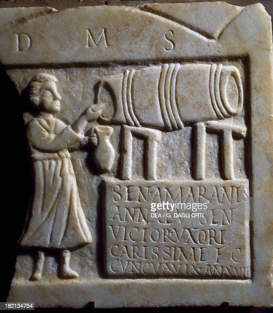 Man pouring wine detail from the funerary stele of Sentria Amarantis Roman Civilisation 3rd century Mérida Museo Nacional De Arte Romano