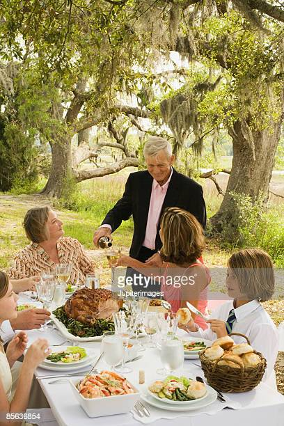 man pouring wine - glazed ham stock pictures, royalty-free photos & images
