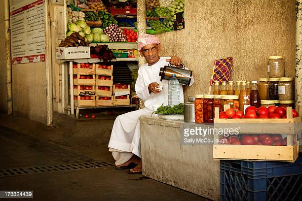 CONTENT] A man pours his morning coffee as he waits to sell or trade his produce at the Dubai Fish Market United Arab Emirates Wednesday May 22nd 2013