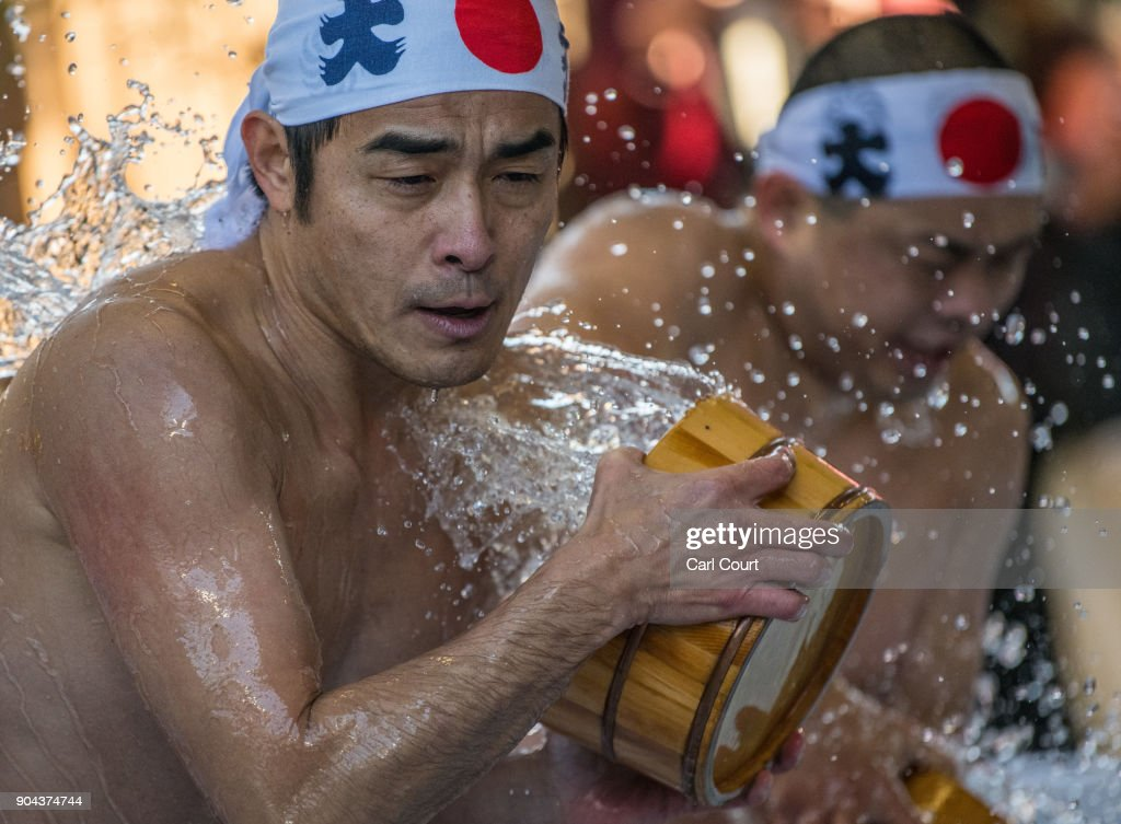 A man pours ice-cold water over himself during a purification ritual at Kanda Myojin shrine on January 13, 2018 in Tokyo, Japan. The coming of age purification ritual is a part of the two-day festival held annually at Kanda Myojin Shrine each January to honour and pay homage to Daikoku, the deity of fortune. Although primarily for 20 year-olds, the ceremony is now undertaken by people of all ages who pour ice-cold water over themselves in pool of water and ice blocks to purify themselves to traditional Japanese music.