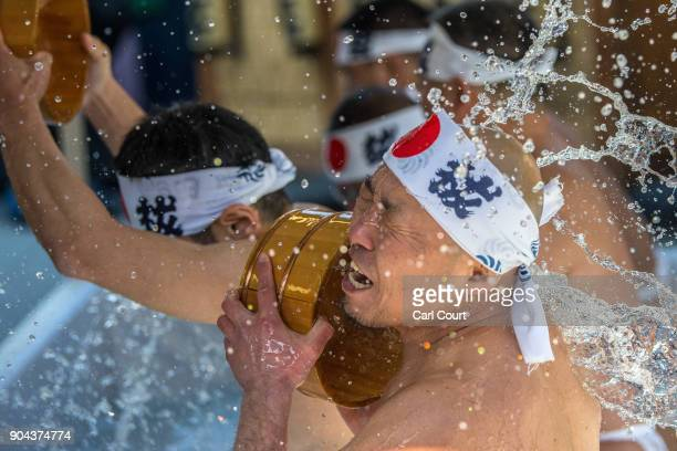 A man pours icecold water over himself during a purification ritual at Kanda Myojin shrine on January 13 2018 in Tokyo Japan The coming of age...