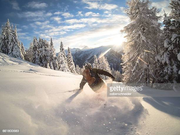 man powder skiing, alps, zauchensee, austria - winter sport stock pictures, royalty-free photos & images