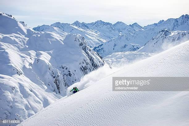 Man Powder Skiing in the Arlberg region of Austrian Alps, Austria