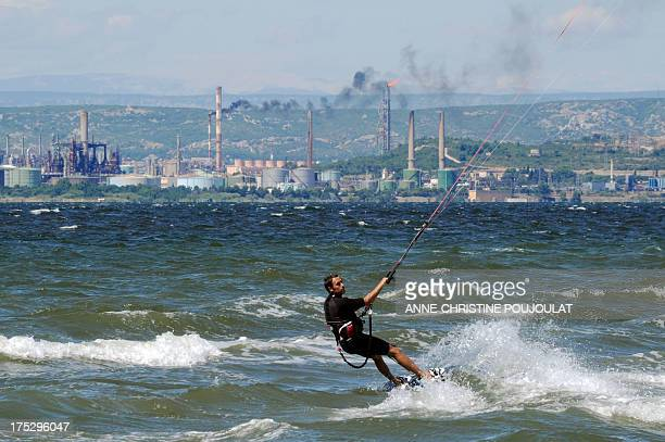 Man practices kitesurfing on the Bolmon pond, on July 29 in Marignane. The GR2013, a hiking trail which crosses through industrial lands and past...