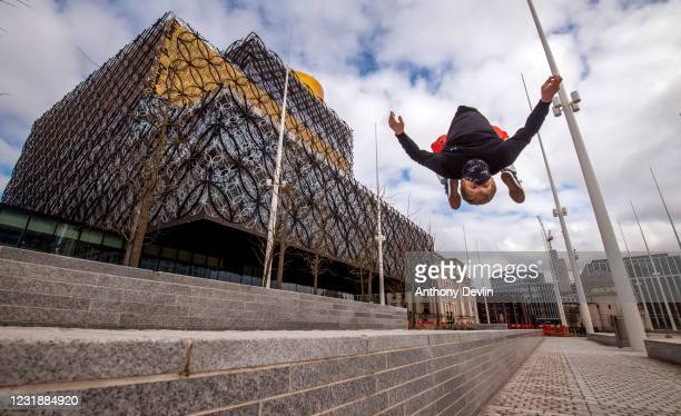 Man practices Parkour outside the Library of Birmingham in Birmingham city centre on March 20, 2020 in Birmingham, England.