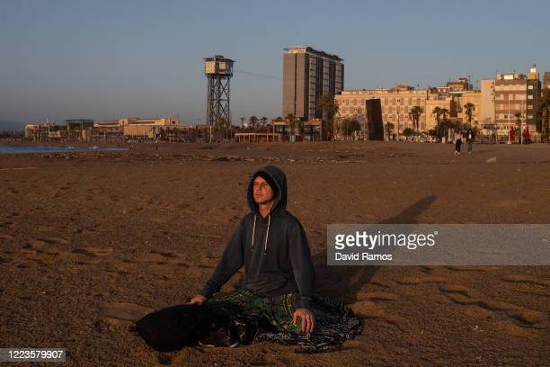 Man practices yoga at dawn at La Barceloneta Beach opened for the first day since March 15 during the novel coronavirus crisis on May 08, 2020 in...