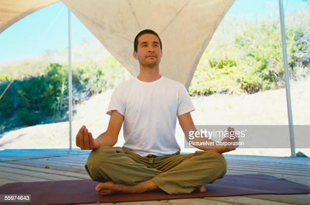 Man practices yoga in outdoor setting